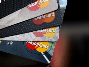 In this file  photo, MasterCard credit cards are displayed for a photographer in Montpelier, Vt.