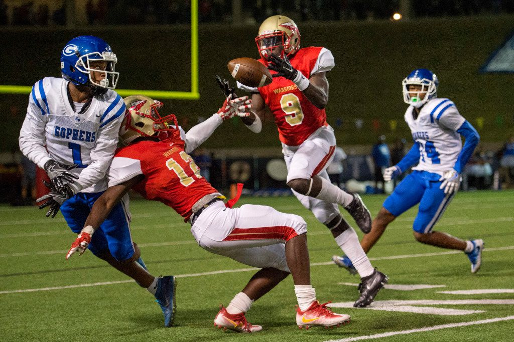 FILE - South Grand Prairie defensive backs Elisha Palm (12) and Atanza Vongor (9) try to come up with an interception on a pass intended for Grand Prairie wide receiver Shaidron Williams (1) in the first half of a game at the Gopher-Warrior Bowl in Grand Prairie on Friday, Sept. 30, 2016. (Jeffrey McWhorter/Special Contributor)