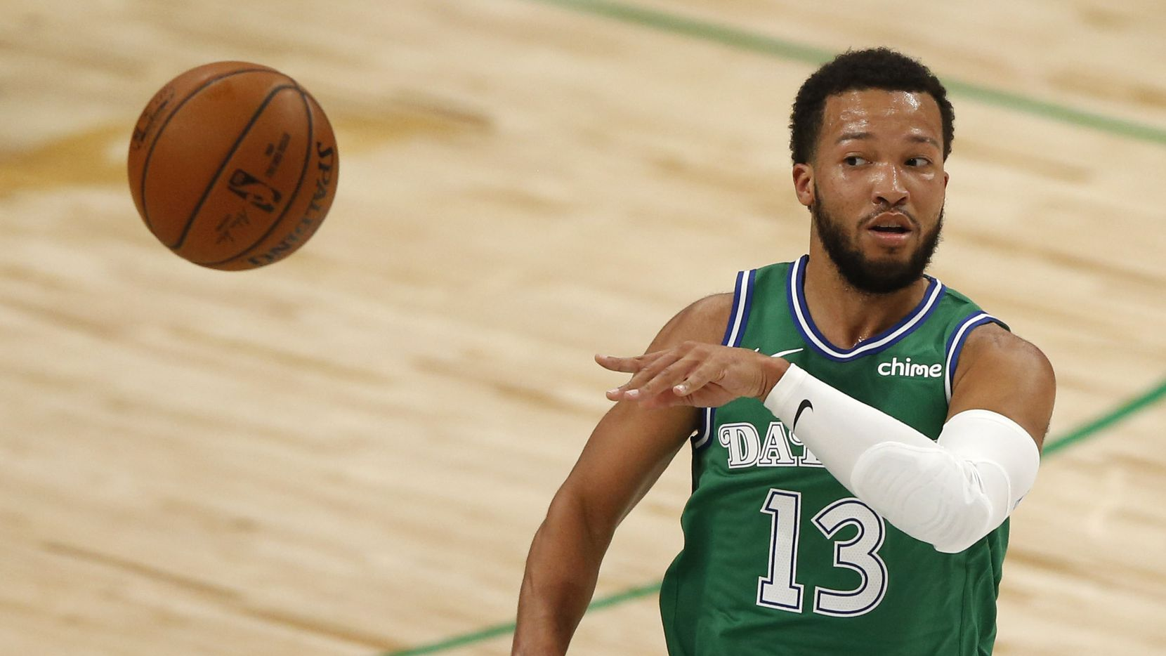 Dallas Mavericks guard Jalen Brunson (13) passes in a game against the Charlotte Hornets during the second quarter of play in the home opener at American Airlines Center on Wednesday, December 30, 2020 in Dallas.