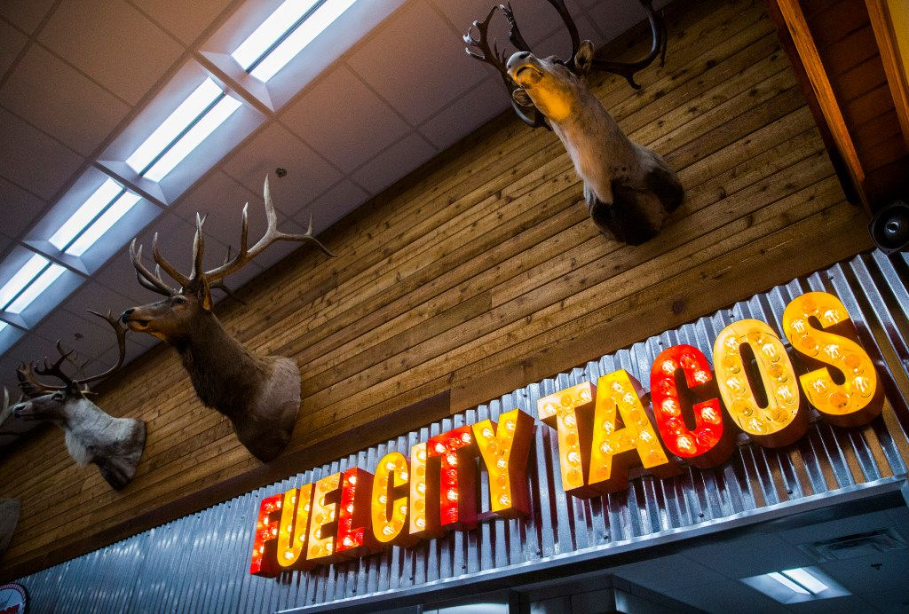 Heads of animals are displayed over the taco window at Fuel City on Haltom Road in Haltom City. (Ashley Landis/The Dallas Morning News)