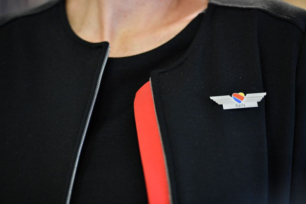 A Southwest Airlines flight attendant works before a flight at Ronald Reagan Washington National Airport.