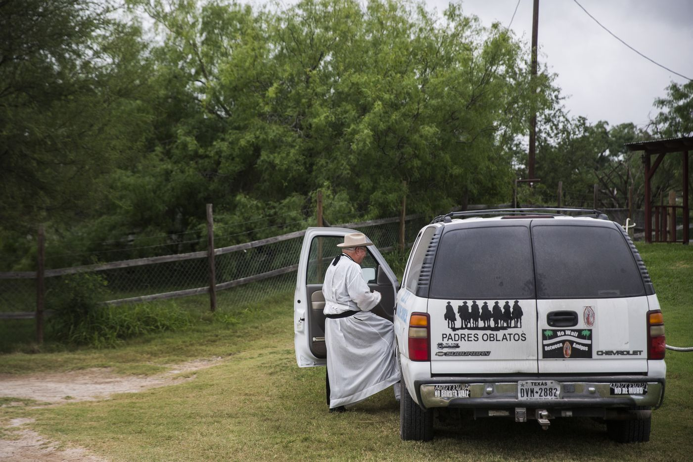 Father Roy Snipes climbs into his white Chevy Suburban after a boat ride on the Rio Grande.