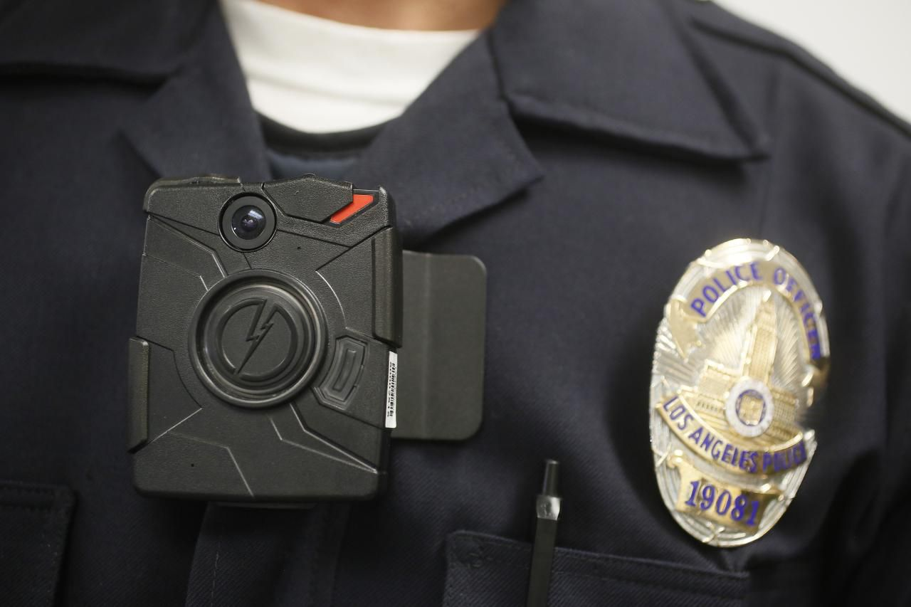 Starting Tuesday, the Dallas Police Department is phasing in the use of body cameras like this one worn by a Los Angeles officer.