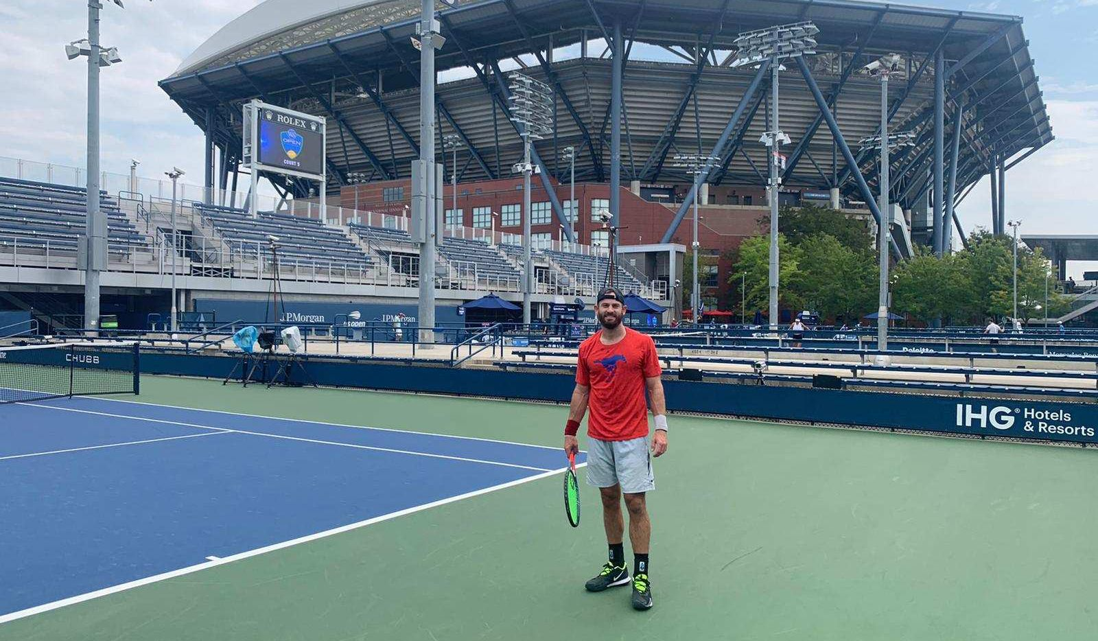 Nate Lammons stands out on a U.S. Open court, donning an SMU shirt. He's standing in front of the famed Arthur Ashe Stadium. Lammons played in the unique 2020 U.S Open.