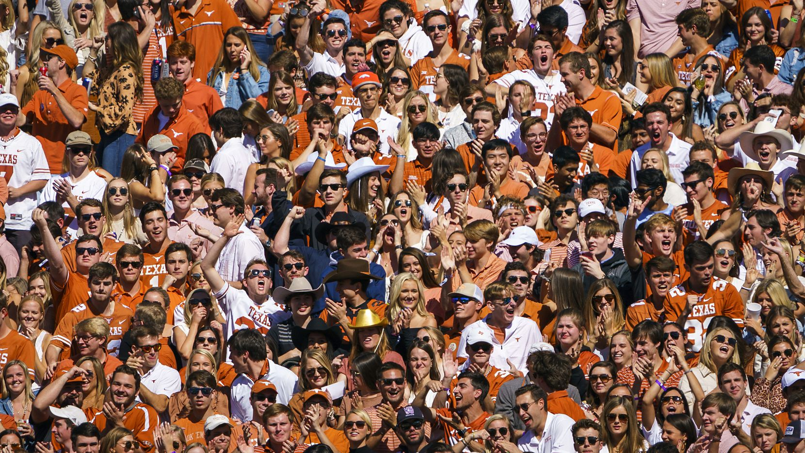 Texas fans cheer during the first half of an NCAA football game against Oklahoma at the Cotton Bowl on Saturday, Oct. 12, 2019, in Dallas.