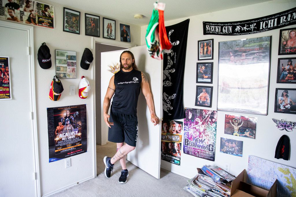 """Professional wrestler Lance Hoyt looks around his home office in his Cedar Hill, Texas home on June 27, 2019. His home contains lots of memorabilia of his own and his friends' wrestling careers. Hoyt, who goes professionally by """"The American Psycho"""" Lance Archer is a professional wrestler in New Japan Pro Wrestling. NJPW is Dallas billionaire Mark Cuban's latest weird obsession — and it's already a monster hit. (Shaban Athuman/Staff Photographer)"""