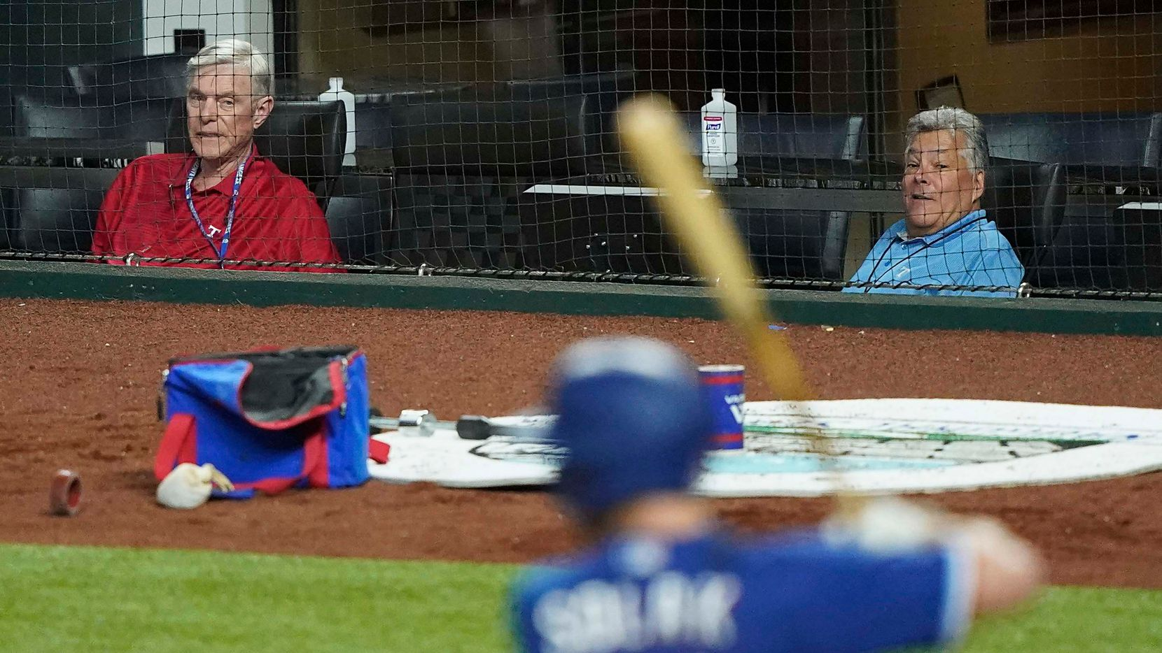 Texas Rangers co-chairman and managing partner Ray C. Davis (left) and chairman, ownership committee and chief operating officer Neil Leibman watch outfielder Nick Solak bat during an exhibition game against the Colorado Rockies at Globe Life Field on Tuesday, July 21, 2020.