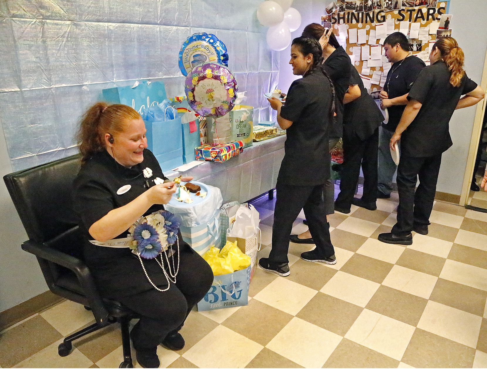 Housekeeping employee Christy Hubbard (left) of Fort Worth enjoyed a baby shower thrown for her by fellow employees at the Grand Hyatt DFW in September.