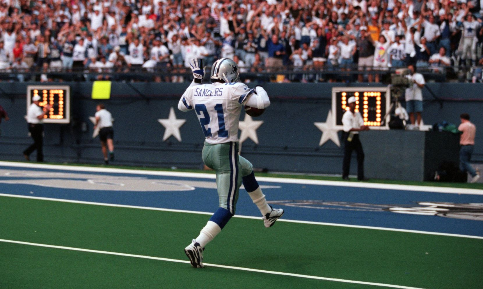 FILE - Cowboys cornerback Deion Sanders (21) celebrates on his way to the end zone after recovering a fumble during a game against the Colts on Sunday, Sept. 15, 1996, at Texas Stadium in Irving.