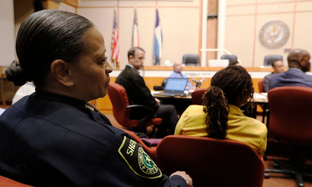 Interim Dallas County Sheriff Marian Brown (left) listens as Dallas County Commissioner John Wiley Price talks during a County Commissioners' meeting Tuesday to discuss ways to take better care of women in the Dallas County Jail.