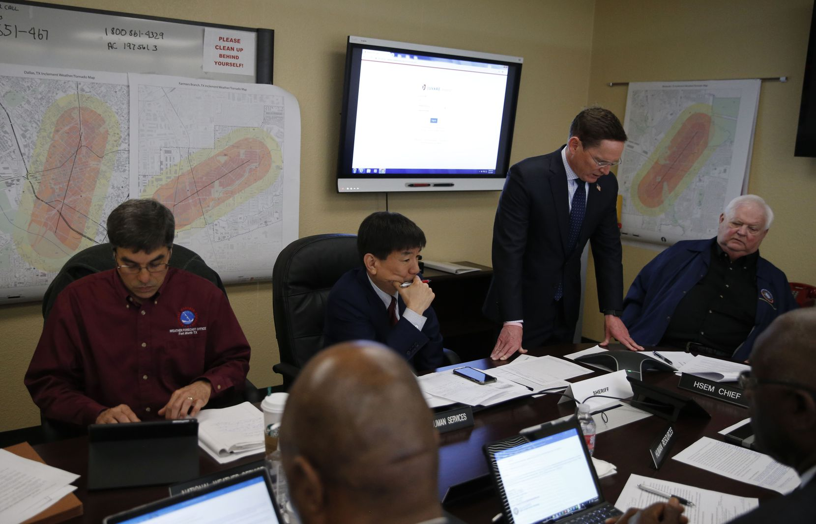 Dallas County Judge Clay Jenkins (standing) talks on a conference call in the policy room during a simulated EF-4 tornado strike at the Dallas County Emergency Operations Center in Dallas on Thursday, March 21, 2019. This was the largest severe weather exercise ever conducted in the D-FW area.