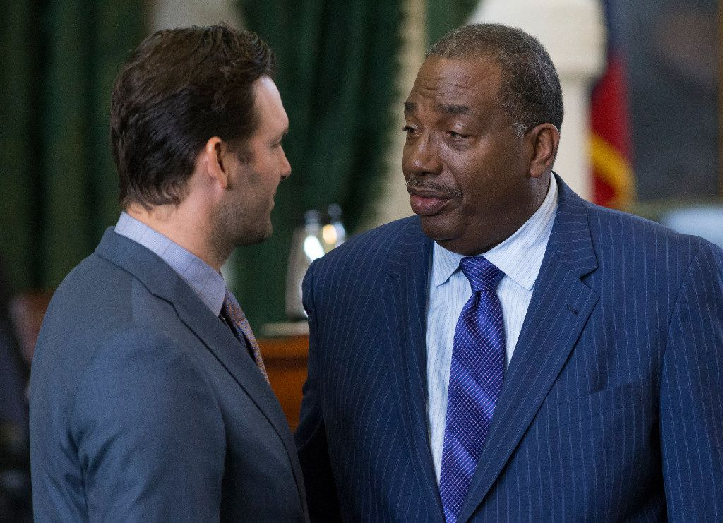 Former Dallas Cowboys quarterback Tony Romo speaks with Sen. Royce West, D-Dallas, as he is recognized by the Senate at the Texas Capitol in Austin, Wednesday, May 3, 2017.