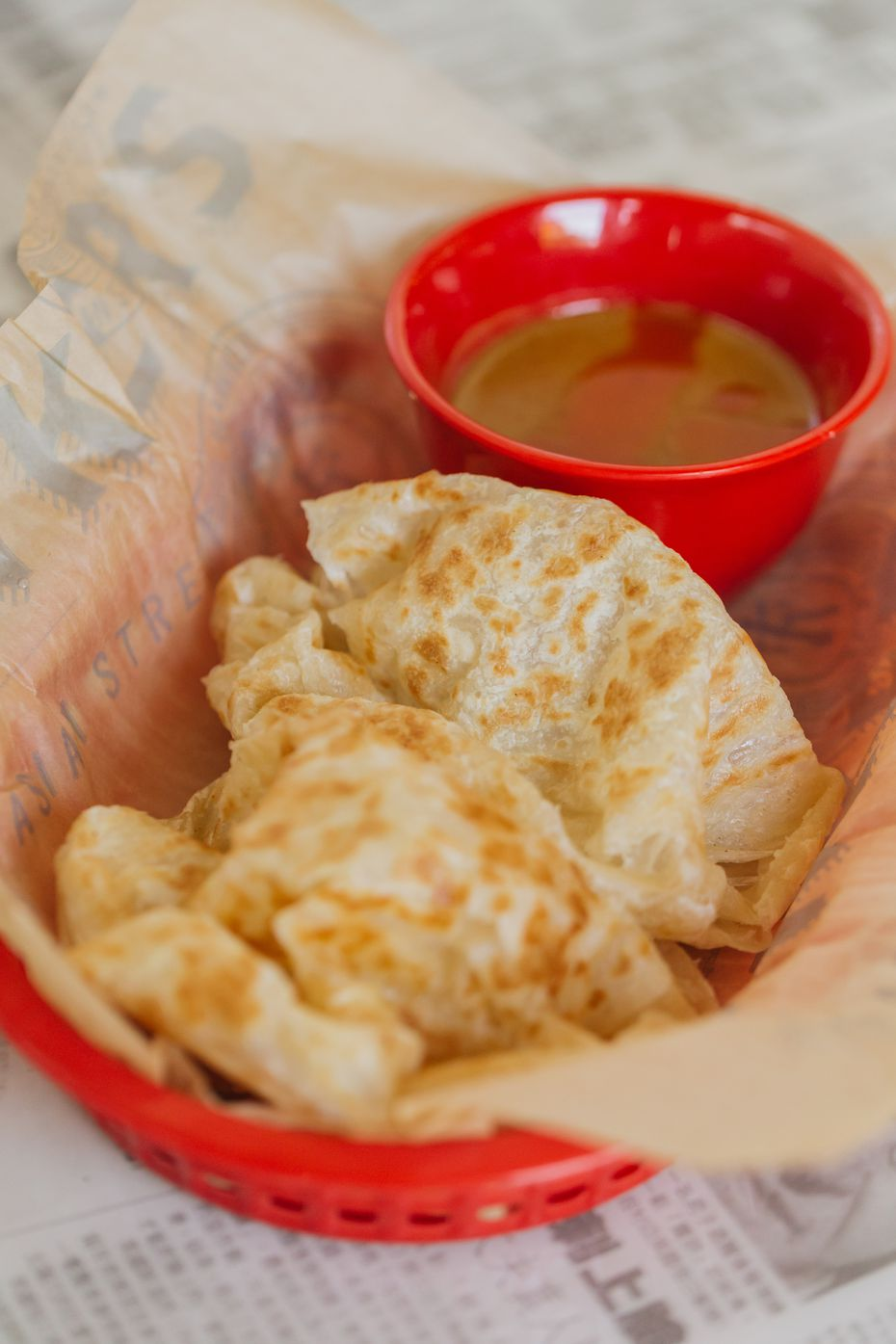 """""""The best part of the roti canai is the curry dipping sauce,"""" says Hawkers Asian Street Food CEO and co-founder Kaleb Harrell. Roti canai is Malaysian flatbread that he describes as where """"phyllo dough meets a croissant meets a biscuit."""""""