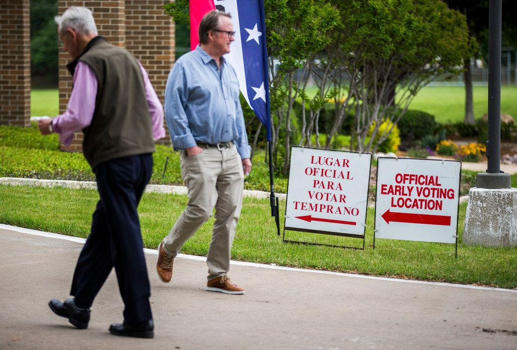 Early voters arrive at and exit Our Redeemer Lutheran Church, an early voting polling place, on Monday, April 29, 2019 in Dallas.