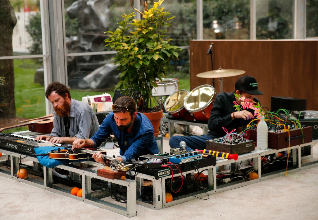Musicians (from left) Jeff Gibbons, Danny Skinner and Gregory Ruppe tune their instruments before the Nasher Prize award gala at the Nasher Sculpture Center in Dallas, Saturday, April 1, 2017. (Tom Fox/The Dallas Morning News)