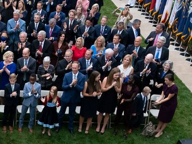 In this Sept. 26, 2020, photo President Donald Trump, center, stands with Judge Amy Coney Barrett as they arrive for a news conference to announce Barrett as his nominee to the Supreme Court, in the Rose Garden at the White House in Washington. Former New Jersey Gov. Chris Christie watches from the fourth row on far right. In front of Christie, Pastor Greg Laurie and Prestonwood Baptist Church pastor Jack Graham, right, attended the news conference. Robert Morris, the senior pastor at Gateway Church in Southlake, is pictured in the fourth row on the far left.