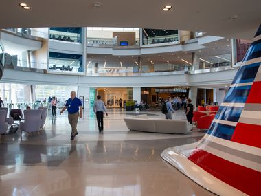 Employees walk through the main lobby of the Skyview 8 building at the new American Airlines campus and headquarters in Fort Worth, Texas, on Sep. 23, 2019. (Lynda M. Gonzalez/The Dallas Morning News)