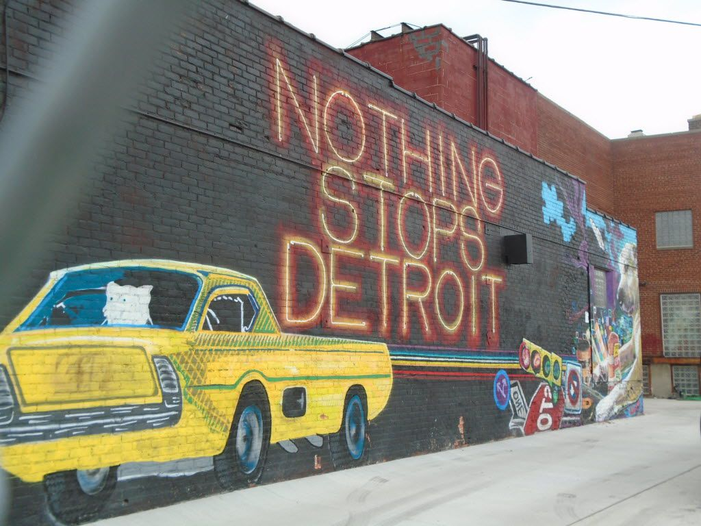 Outdoor murals energize Detroit's Eastern Market and other districts.