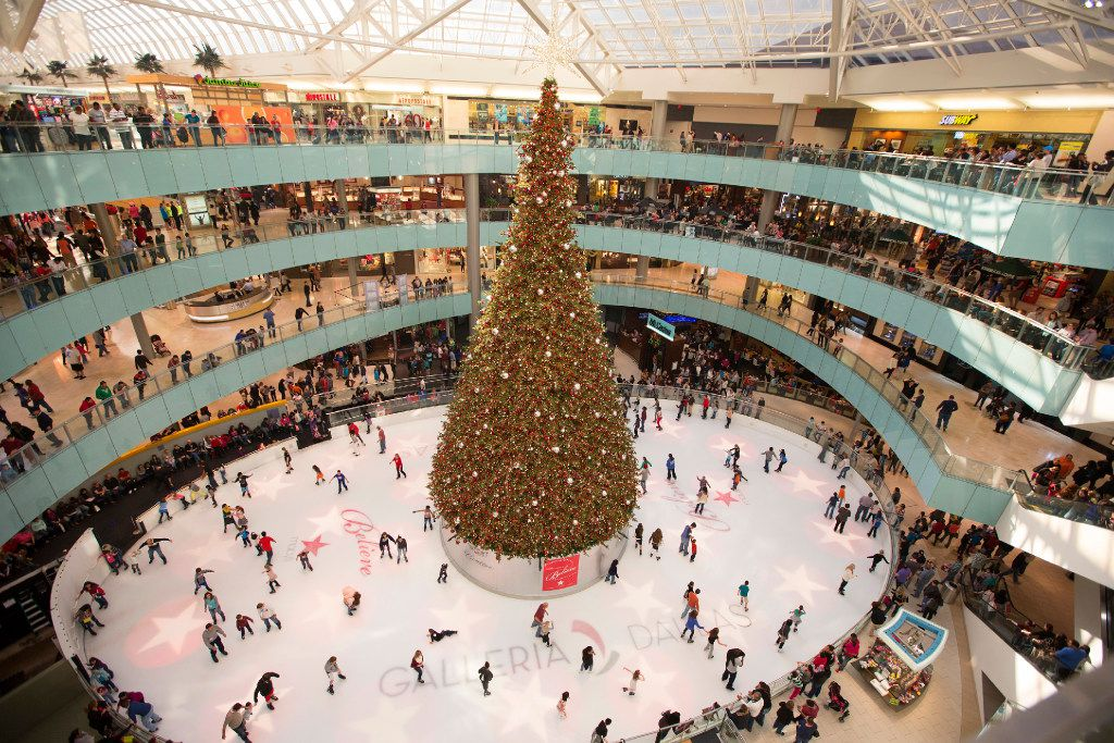 Galleria Dallas' holiday decorations include a huge indoor Christmas tree on the ice rink.