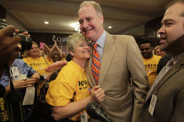 Southwest Airlines employee Suzanne Hollandsworth embraces CEO Gary Kelly on Wednesday after the Houston City Council approved an expansion of Hobby Airport that would allow Southwest to operate international flights there.