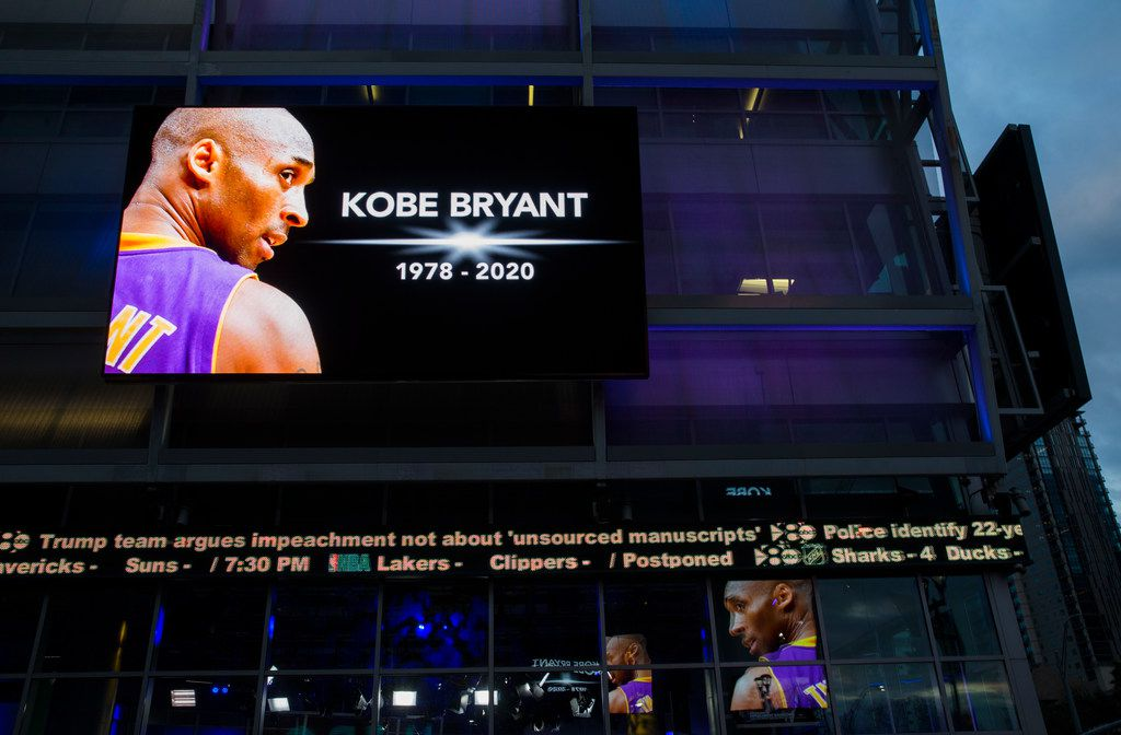 Large screens display a tribute to former Los Angeles Laker Kobe Bryant and his daughter, Gianna Bryant, before an NBA game between the Dallas Mavericks and the Phoenix Suns on Jan. 28, 2020 at the American Airlines Center in Dallas. The future NBA Hall of Famer and his 13-year-old daughter were killed on Sunday in a helicopter accident in California. (Ashley Landis/The Dallas Morning News)