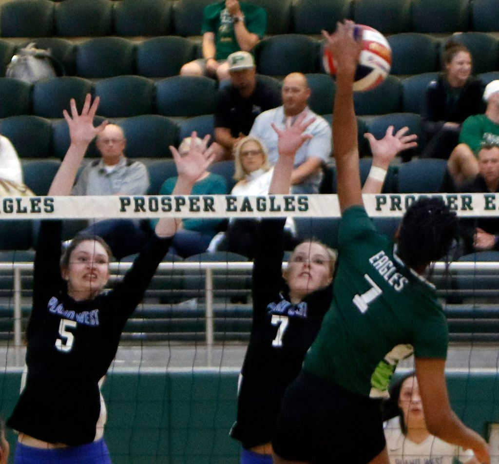 Prosper's Bailey Birmingham (7) powers a spike past the defense of Plano West defenders Hunter Anderson (5) and Jill Pressly (7) during the first game of their match. The two teams played their District 9-6A volleyball match at Prosper High School in Prosper on October 22, 2019. (Steve Hamm/ Special Contributor)