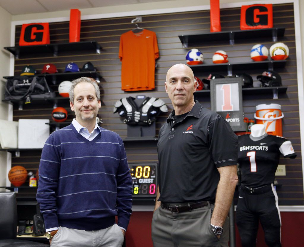 Varsity Brands CEO Adam Blumenfeld, left, and Terry Babilla, president of BSN Sports, one of Varsity's three businesses, at their main headquarters in Dallas. Varsity said it did $2 billion in sales last year and, despite the pandemic, was adding to its cash pile these past few months.