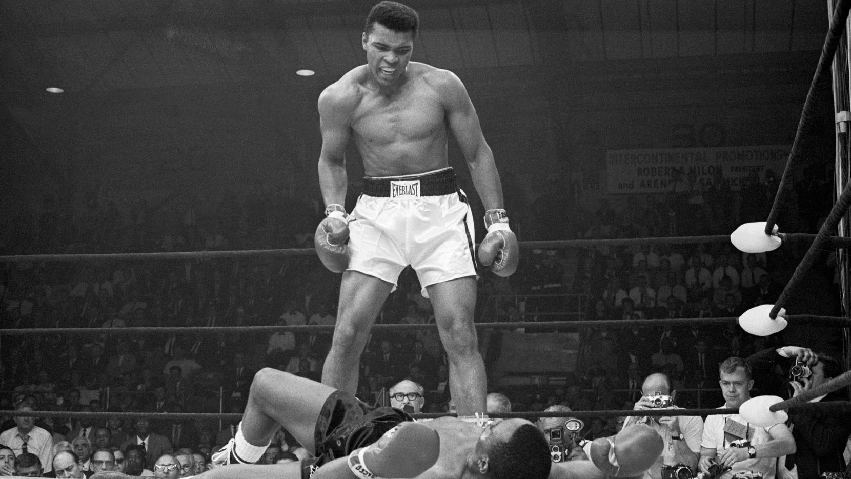 Heavyweight champion Muhammad Ali stood over Sonny Liston and taunted him to get up during their 1965 title fight. Ali knocked Liston out in one minute in the first round during their bout at the Central Maine Youth Center in Lewiston, Maine.