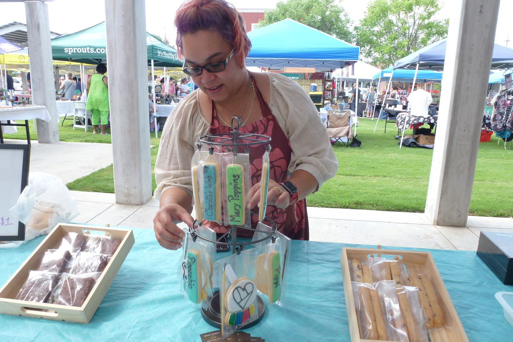 Michelle Bickford makes custom-designed sugar-cookie sticks, among other baked goodies, for her Emotions Made Edible bakery in Arlington.