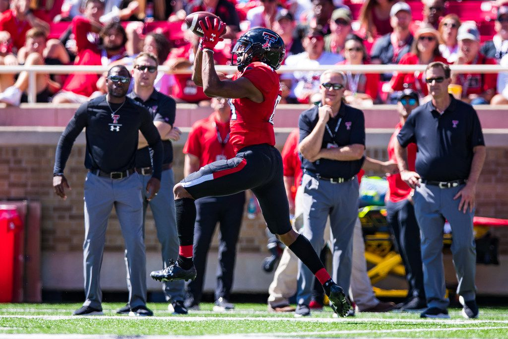 LUBBOCK, TEXAS - OCTOBER 05: Wide receiver Erik Ezukanma #84 of the Texas Tech Red Raiders catches a pass during the second half of the college football game against the Oklahoma State Cowboys on October 05, 2019 at Jones AT&T Stadium in Lubbock, Texas.