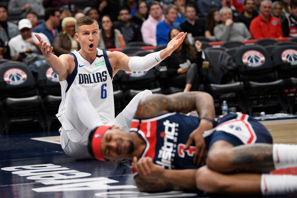 Dallas Mavericks forward Kristaps Porzingis (6) gestures after he was called for a foul against Washington Wizards guard Bradley Beal, foreground, during the second half of an NBA basketball game, Friday, Feb. 7, 2020, in Washington. (AP Photo/Nick Wass)