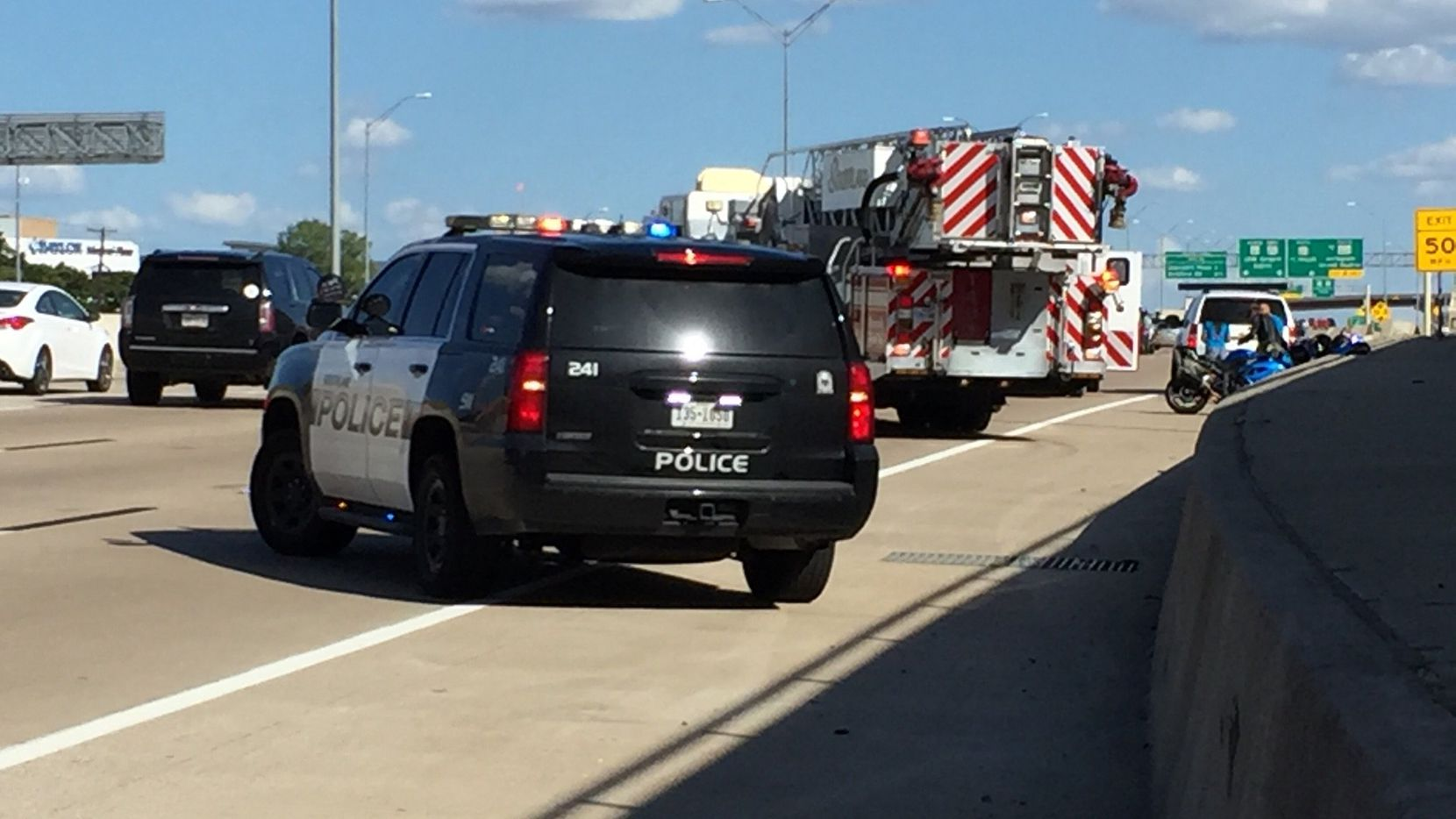 Southlake police block off traffic on State Highway 114 after about 100 motorcyclists caused the road to shut down after one of them crashed Saturday.