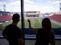 Ross McCall with FIFA (left) listens to Megan Miller, Vice President of Partnership Marketing for FC Dallas, talk about Toyota Stadium during a FIFA delegates tour on Saturday, Oct. 23, 2021, at the National Soccer Hall of Fame in Frisco. (Juan Figueroa/The Dallas Morning News)