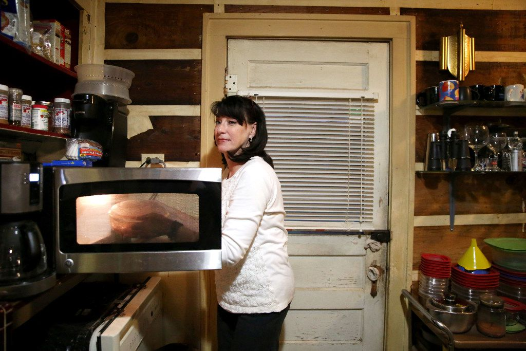 "Dawn, reheating spaghetti sauce before dinner, calls student loan debt her ""quiet reality."""