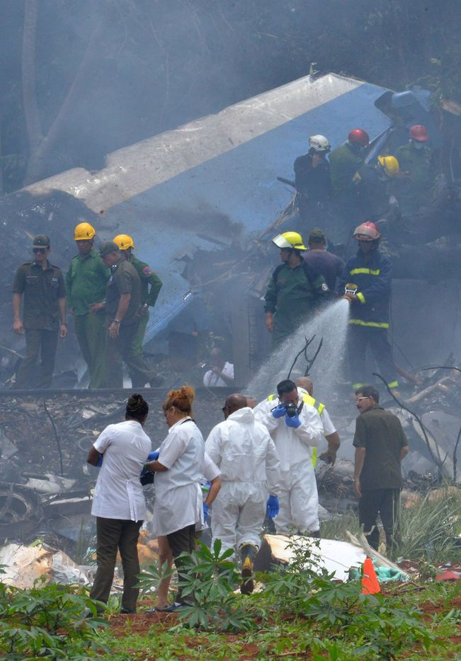 "Emergency personnel works at the site of the accident after a Cubana de Aviacion aircraft crashed after taking off from Havana's Jose Marti airport on May 18, 2018. A Cuban state airways passenger plane with 113 people on board crashed on shortly after taking off from Havana's airport, state media reported. The Boeing 737 operated by Cubana de Aviacion crashed ""near the international airport,"" state agency Prensa Latina reported. Airport sources said the jetliner was heading from the capital to the eastern city of Holguin."