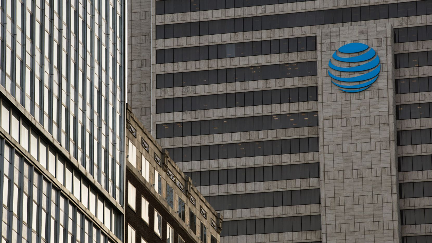 The AT&T Headquarters building in downtown Dallas is pictured in this file photo. The company's job fair will take place in Richardson on Wednesday.