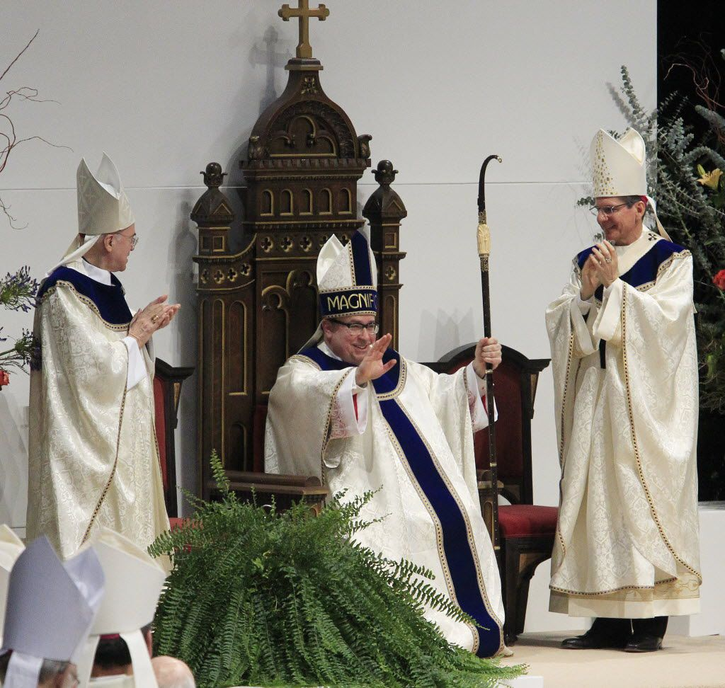 Fort Worth Bishop Michael Olson (center, shown at his 2014 ordination) said through a spokeswoman that he stands by his decision to accept the resignation of Kirkham.