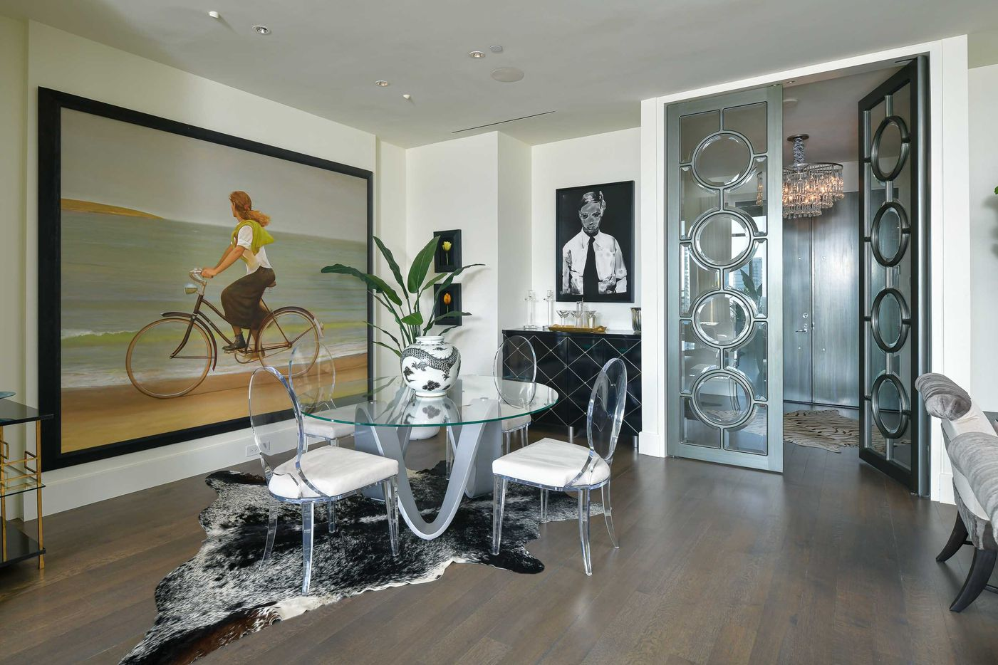 Take a look at this penthouse apartment at 1717 Arts Plaza, Unit #2307 in Dallas. The two-story penthouse in the One Arts Plaza building has three bedrooms, three bathrooms and one half-bathroom, plus two terraces.