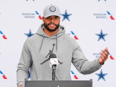 Dallas Cowboys quarterback Dak Prescott addresses reporters following a practice at training camp on Wednesday, Aug. 11, 2021, in Oxnard, Calif.