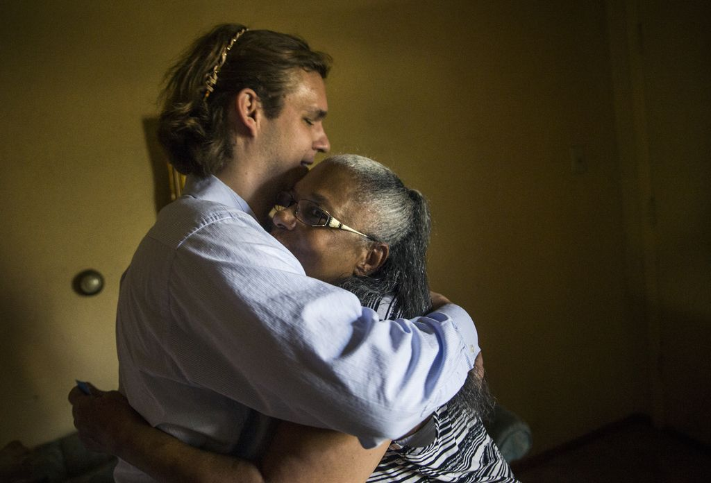 Belinda Darden embraces tax consultant Will Toler at her Hamilton Park home Wednesday, August 28, 2018 in Dallas. Darden, whose family has occupied the home since 1968, has enlisted the help of tax consultants Toby and Will Toler, who are working pro bono to help residents of Hamilton Park stay in their homes at a time of rising property values.