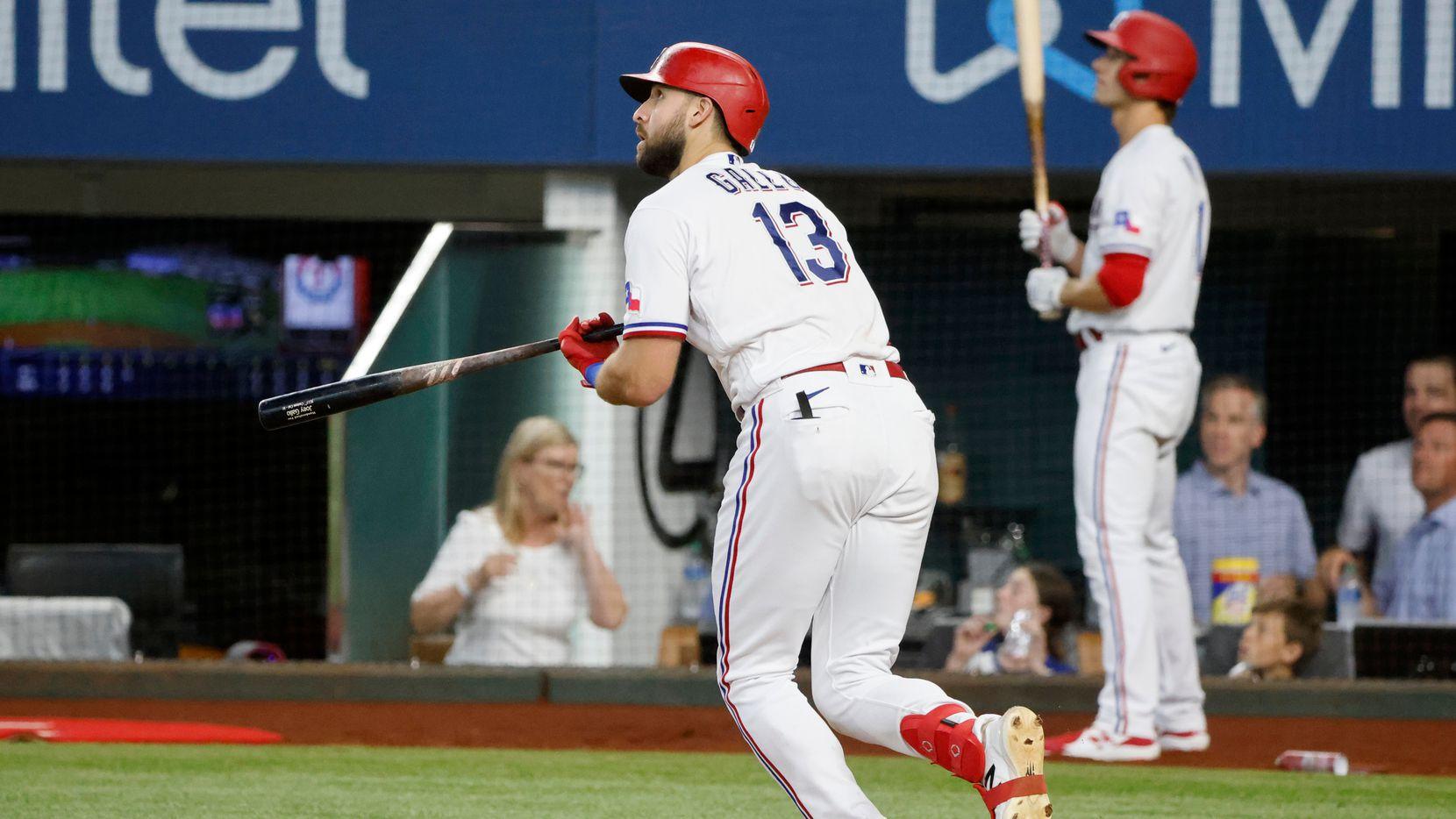 Texas Rangers' Joey Gallo (13) watches his three-run home run against the Kansas City Royals during the fourth inning of a baseball game Saturday, June 26, 2021, in Arlington, Texas. (AP Photo/Michael Ainsworth)