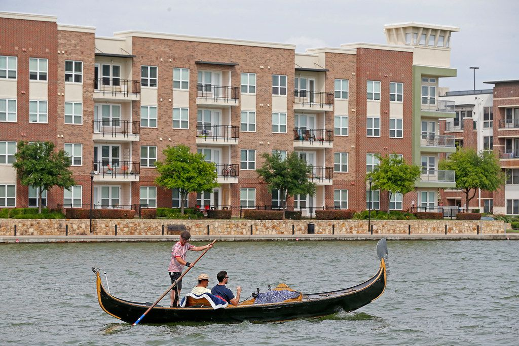 Brendan Meyer and reader Ayhan Calis ride a gondola guided by gondolier Tomy Dudley on Lake Carolyn in Irving.
