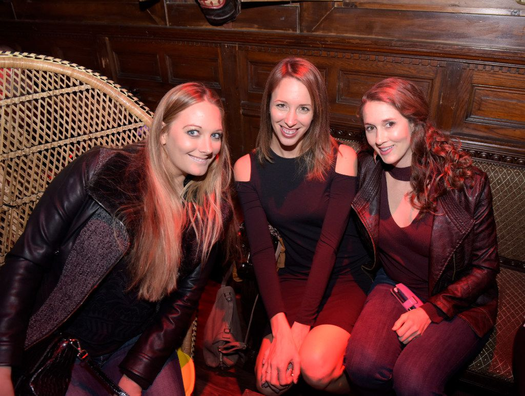 Tori Thompson, left, Alei Cook, center, and Samantha Temars enjoy a night at Pilikia, a tiki bar on Ross Ave., open in the former Three Sheets location.