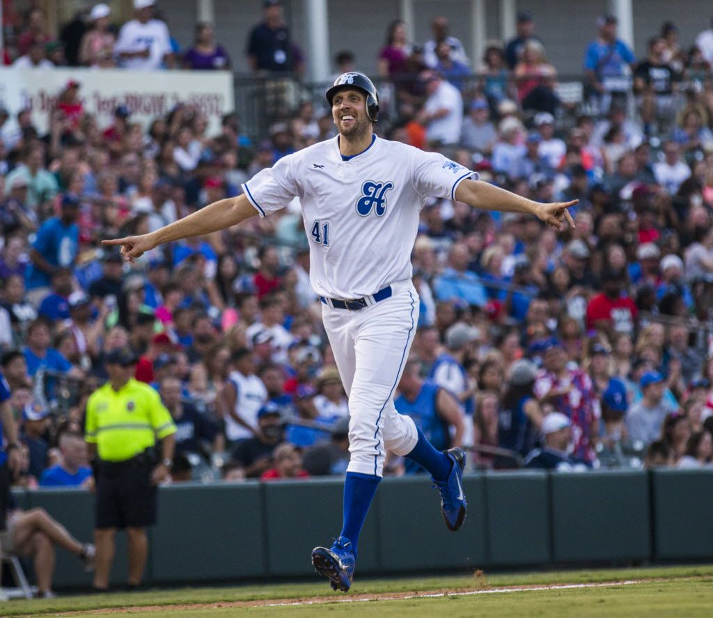 Dallas Mavericks power forward Dirk Nowitzki celebrates as he runs home to put a point on the board during Dirk Nowitzki's 2016 Heroes Celebrity Baseball Game on Friday, June 10, 2016 at Dr Pepper Ballpark in Frisco, Texas.  (Ashley Landis/The Dallas Morning News)