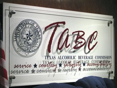 In this Monday, Sept. 21, 2009 photo, the logo of the Texas Alcoholic Beverage Commission is shown in the commission  hearing room as shown, in Austin, Texas.