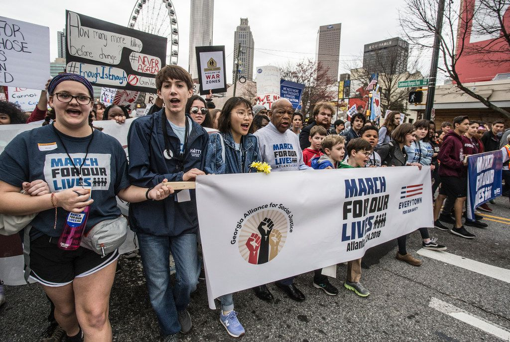 U.S. Rep. John Lewis leads a march of thousands through the streets of Atlanta, Ga., on Saturday, March 24, 2018. Participants in Atalanta and across the nation rallied against gun violence and in support of stricter gun control. (AP Photo/ Ron Harris)