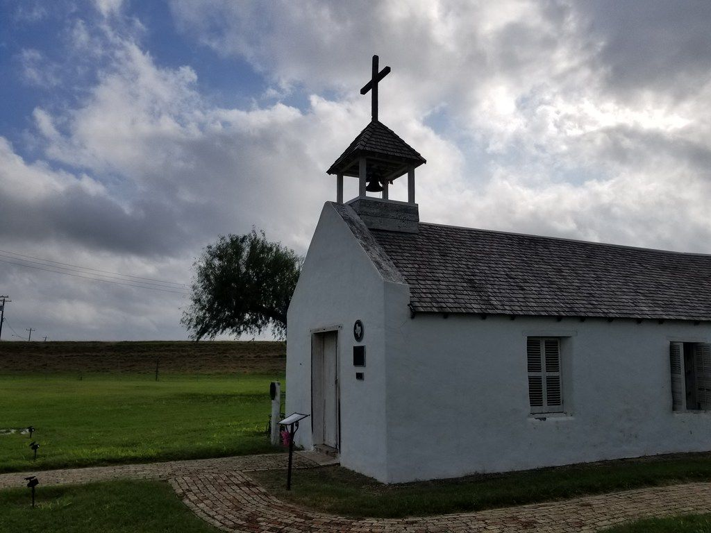 The historic La Lomita Mission in Mission, Texas, built in 1865, sits inside the Rio Grande flood plain in this photo taken Sunday Oct. 14, 2018. The Department of Homeland Security plans to build a border wall on the levee road behind the chapel, with 18 foot metal bollards rising above the current level of the road. Church leaders and local residents fear the chapel and its grounds will be cut off and unusable.
