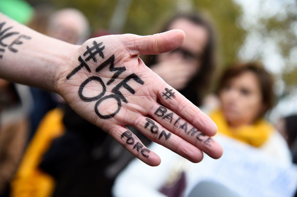 "A picture shows the message ""Me too"" on the hand of a protester during a gathering against gender-based and sexual violence called by the Effronte-e-s Collective, on the Place de la Republique square in Paris on October 29, 2017."