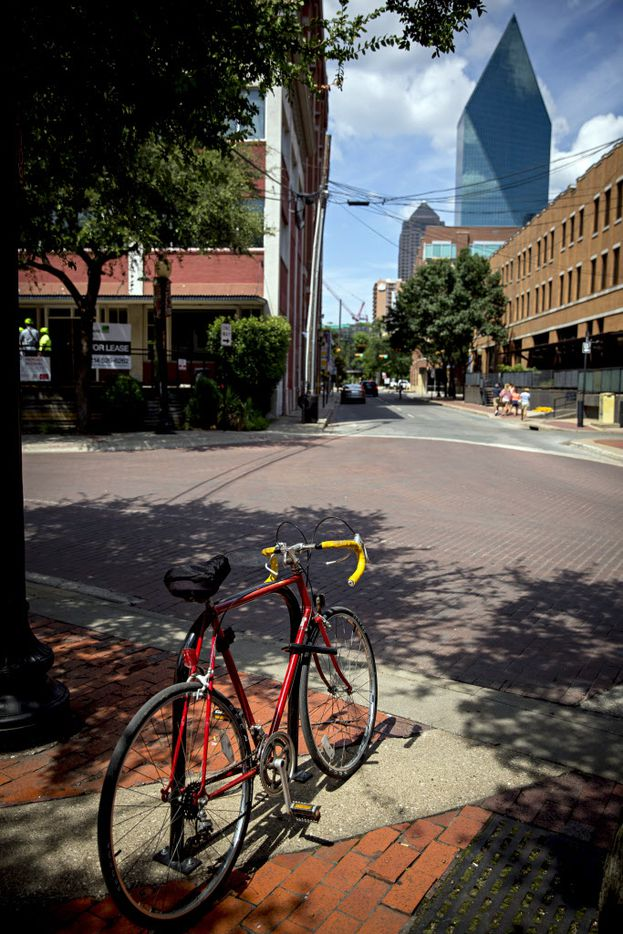 A bicycle is locked to a bike rack in the West End Wednesday, July 29, 2016 in Dallas. The downtown area will be part of a pilot program that will introduce improvements such as better lighting, digital kiosks and bike sharing. (G.J. McCarthy/The Dallas Morning News)