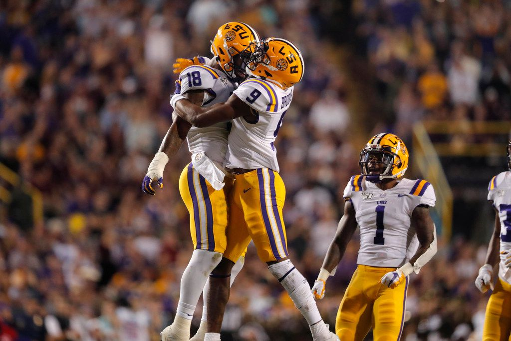 LSU safety Marcel Brooks (9) and linebacker K'Lavon Chaisson (18) celebrate a sack during the first half of the team's NCAA college football game against Texas A&M in Baton Rouge, La., Saturday, Nov. 30, 2019. (AP Photo/Gerald Herbert)